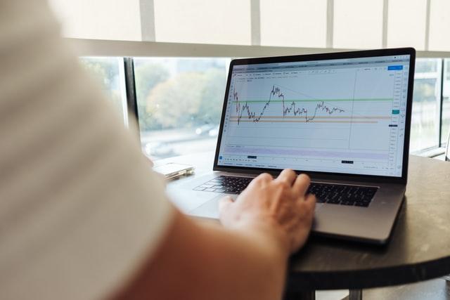 Why do companies buy back stock